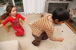 Children chasing round a room