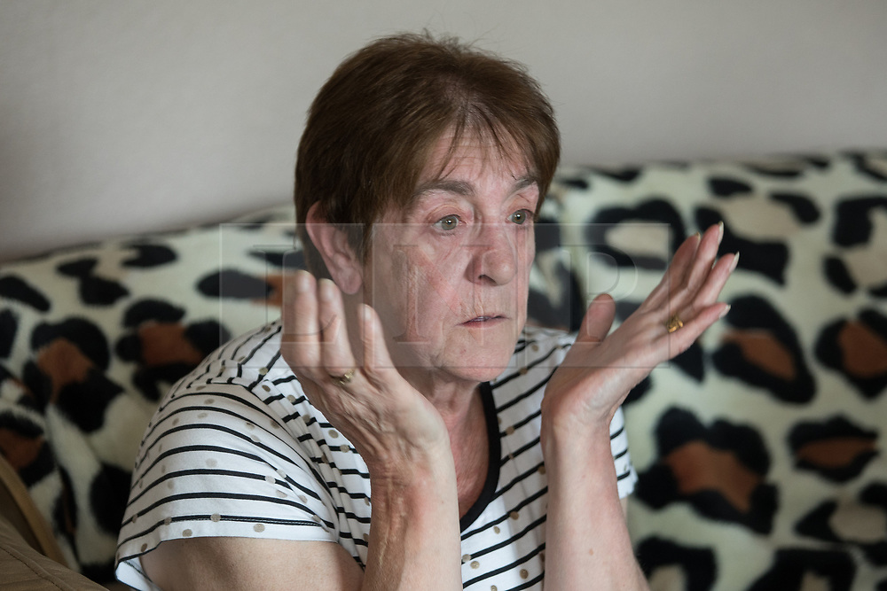 © Licensed to London News Pictures . 06/07/2017 . Manchester , UK . BARBARA DRANSFIELD reacts as Charles Salvador sings What a Wonderful World to her via Paula Williamson's phone on loudspeaker . Artwork by convicted criminal  Charles Salvador (previously Charles Bronson) has been sold on behalf of Salvador to raise a £1,000 to support Barbara and Len Dransfield . Barbara , who has become friendly with Salvador , was brought the money and a card by Salvador's fiance , Paula Wiliamson . Barbara Dransfield was brutally assaulted by masked robbers as she sat at home in her wheelchair . She suffered extensive injuries to her face and body . Photo credit : Joel Goodman/LNP