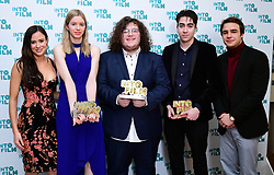 Camilla Thurlow and Nico Mirallegro present Oisin Thomas, Ruda Santos and Emilija Morrison with the Ones To Watch award during the fifth annual Into Film Awards, held at the Odeon Luxe in Leicester Square, London.