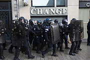 December, 8th, 2018 - Paris, Ile-de-France, France: 'Change' sign with Riot police on Champs Elysees. The French 'Gilets Jaunes' demonstrate a fourth day. Their movement was born against French President Macron's high fuel increases. They have been joined en mass by students and trade unionists unhappy with Macron's policies. Nigel Dickinson