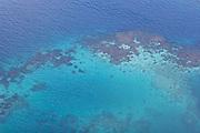 Aerial shot of a coral reef between Savaii and Upolu, Western Samoa.