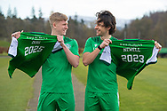 (LtoR) Josh Doig (#25) and Joe Newell (#11) both sign new contracts during the press conference for Hibernian FC at the Hibs Training Centre, Ormiston, Scotland on 26 February 2021, ahead of the SPFL Premiership match against Motherwell.