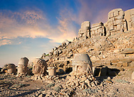 Statue heads at sunset , from right, Zeus, Commagene, Antiochus, & Eagle, with headless seated statues in front of the stone pyramid 62 BC Royal Tomb of King Antiochus I Theos of Commagene, east Terrace, Mount Nemrut or Nemrud Dagi summit, near Adıyaman, Turkey .<br /> <br /> If you prefer to buy from our ALAMY PHOTO LIBRARY  Collection visit : https://www.alamy.com/portfolio/paul-williams-funkystock/nemrutdagiancientstatues-turkey.html<br /> <br /> Visit our CLASSICAL WORLD HISTORIC SITES PHOTO COLLECTIONS for more photos to download or buy as wall art prints https://funkystock.photoshelter.com/gallery-collection/Classical-Era-Historic-Sites-Archaeological-Sites-Pictures-Images/C0000g4bSGiDL9rw