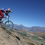 Jarrah Davies, Australia, in action during the New Zealand South Island Downhill Cup Mountain Bike series held on The Remarkables face with a stunning backdrop of the Wakatipu Basin. 150 riders took part in the two day event. Queenstown, Otago, New Zealand. 9th January 2012. Photo Tim Clayton