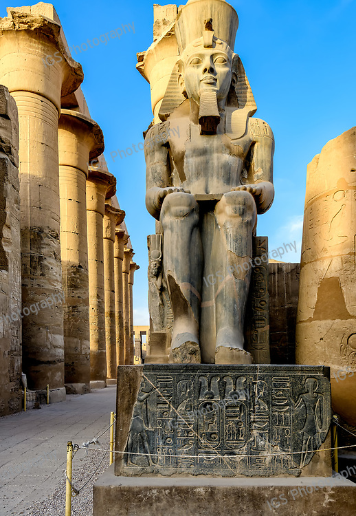 Statue of Ramesses II in front of the papyrus columns of the central colonnade of Amenhotep III at Luxor Temple