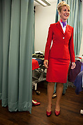 CRAWLEY, WEST SUSSEX, UK, OCTOBER 27TH 2011. Journalist / writer Andrea Sachs puts on her uniform during research on a story about Virgin Atlantic air stewardess and steward training at The Base training facility. (Photo by Mike Kemp for The Washington Post)