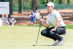 May 4, 2019 - Charlotte, NC, U.S. - CHARLOTTE, NC - MAY 04: Rory McIlroy asks a spectator to be still while reading his lie on the green during the third round of the Wells Fargo Championship at Quail Hollow on May 4, 2019 in Charlotte, NC. (Photo by William Howard/Icon Sportswire) (Credit Image: © William Howard/Icon SMI via ZUMA Press)