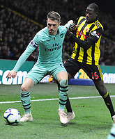 Football - 2018 / 2019 Premier League - Watford vs. Arsenal<br /> <br /> Aaron Ramsey of Arsenal and Abdoulaye Doucoure of Watford at Vicarage Road.<br /> <br /> COLORSPORT/ANDREW COWIE