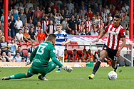 Brentford Forward Ollie Watkins (11) gets taken down by QPR goalkeeper Matt Ingram (13) to be given a penalty during the EFL Sky Bet Championship match between Brentford and Queens Park Rangers at Griffin Park, London, England on 21 April 2018. Picture by Andy Walter.