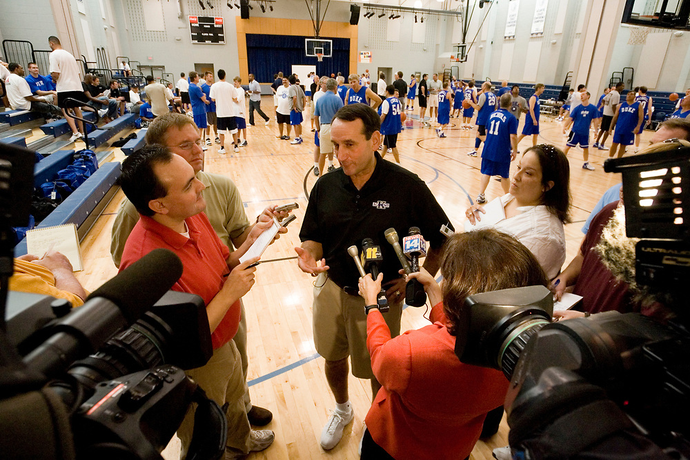 Coach K Academy 2007.  Coach K is interviewed by local media at the start of the camp. Group photo of all coaches and players on the 2001 national championship floor in the Emily K Center.