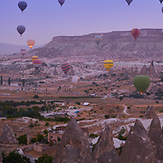 Hot air balloons over the Goreme valley at sunrise, Cappadocia, Turkey