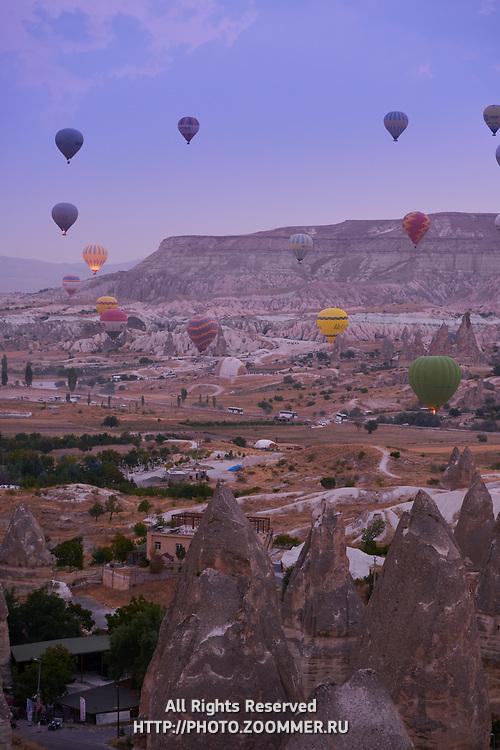 Hot air balloons over the Goreme valley at sunrise, Cappadocia, Turkey