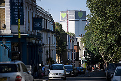 © Licensed to London News Pictures. 23/08/2019. London, UK. Grenfell Tower looms over Notting Hill, West London ahead of the 2018 Notting Hill Carnival which starts this weekend. Warm weather is expected over the bank holiday weekend with carnival attracting over 1 million people to the capital. Photo credit: Ben Cawthra/LNP