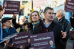 © Licensed to London News Pictures. 18/11/2019. RICKMANSWORTH, UK.  Former Justice Secretary David Gauke (2R) campaigns in Rickmansworth as an independent candidate to be the MP of South West Hertfordshire, the seat he has held since 2005.  Offering support to him on the general election campaign trail is former Home Secretary Amber Rudd (C), who has announced she will not be standing as an MP.  Photo credit: Stephen Chung/LNP