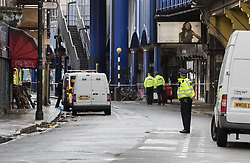 © Licensed to London News Pictures. 18/08/2017. London, UK. Police guard the crime scene in Atlantaic road after man died from stab wounds after an incident in Brixton. Police launched a murder investigation after being called at 12:50 hrs today. Photo credit: Peter Macdiarmid/LNP