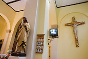 Jesus on the cross with TV screen inside at St. Lawrence's Catholic church in Feltham, London.