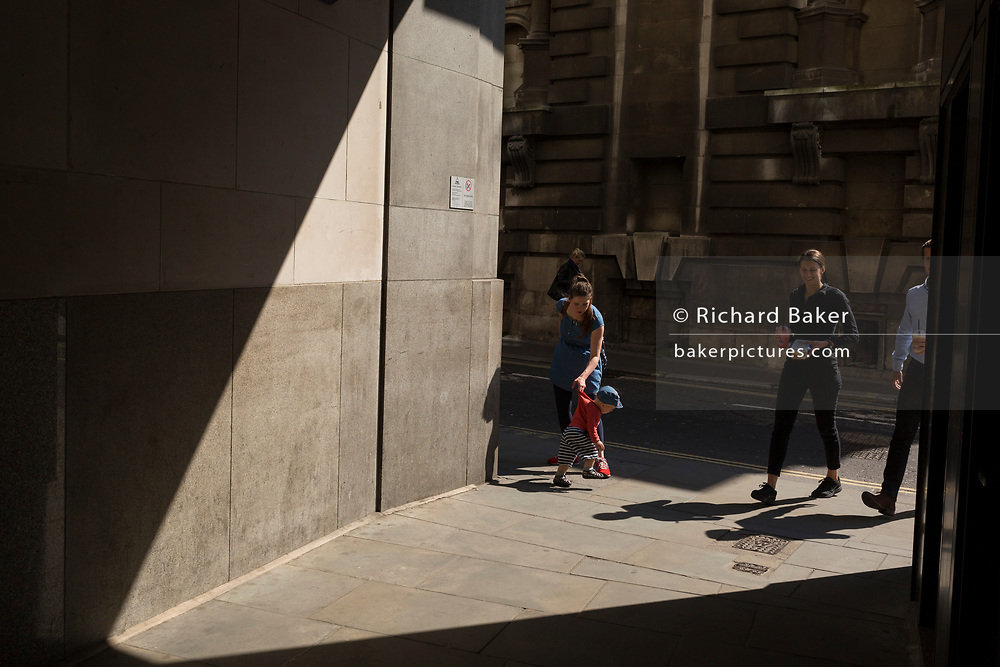 A mother and small child in Lombard Street in the City of London, the capital's financial district aka the Square Mile, on 15th May 2018, in London, UK.