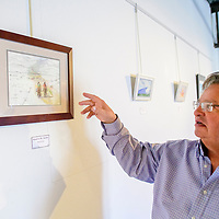 """Robert Gallegos describes """"Road to Mt. Taylor"""" by Beth Klotz at the Double Six gallery in Grants Tuesday.  This is the 13th year of the Mount Taylor theme exhibit."""