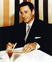 1955 Errol Flynn sings autographs at Mocambo Nightclub