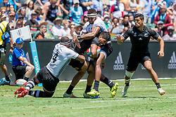 July 22, 2018 - San Francisco, CA, U.S. - SAN FRANCISCO, CA - JULY 22: New Zealand's Dylan Collier is surrounded by Fiji defenders during the semifinal match between New Zealand and Fiji at the Rugby World Cup Sevens on July 22, 2018 at AT&T Park in San Francisco, CA. (Photo by Bob Kupbens/Icon Sportswire) (Credit Image: © Bob Kupbens/Icon SMI via ZUMA Press)