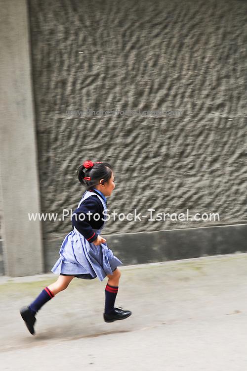 Young girl in uniform on the way to school Darjeeling, West Bengal, India