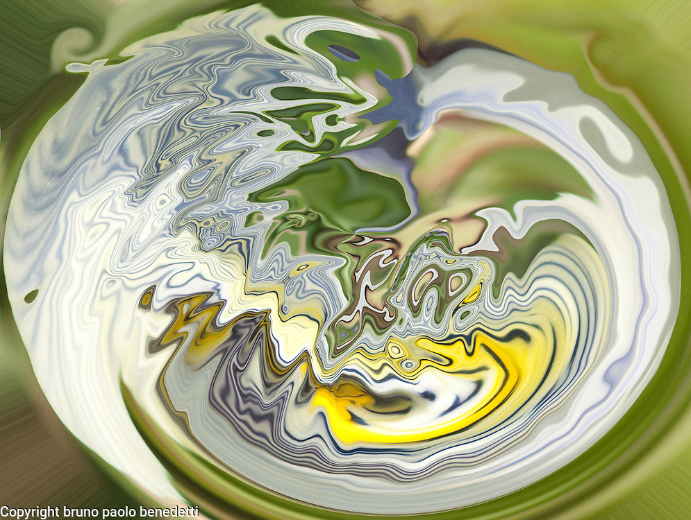 Blue and yellow shades in round fluid shape on blurred green background.