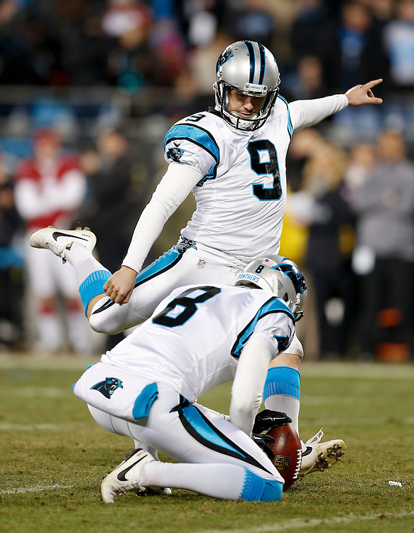 CHARLOTTE, NC - JAN 24:  Kicker Graham Gano #9 of the Carolina Panthers kicks a field goal attempt with punter Brad Norman #8 holding during the NFC Championship game against the Arizona Cardinals at Bank of America Stadium on January 24, 2016 in Charlotte, North Carolina.
