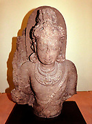 Standing Deity, possibly Shiva 600-700 Chalukya period.  Basalt, South-west India.  The Deccan formed at times a cultural bridge between the arts of the north and the south.  Its medieval rock-cut temples of Ajanta and Ellora are among the most famous in