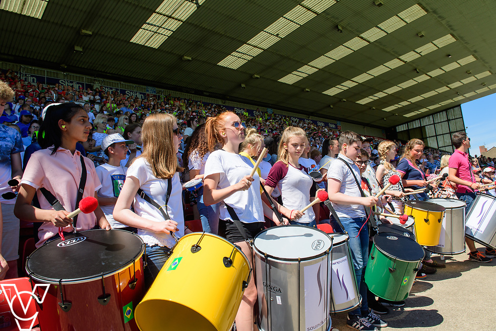 Samba City! at Sincil Bank Stadium, Home of Lincoln City Football Club. More than 2,000 children from 33 schools have  taken part in an event, organised by Lincolnshire Music Service and In partnership with Louder than Life Ltd to create the worlds largest Samba band. <br /> <br /> Picture: Chris Vaughan Photography for Lincolnshire Music Service<br /> Date: June 26, 2018
