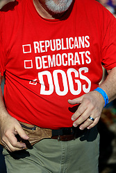 31 January 2016. New Orleans, Louisiana.<br /> Mardi Gras Dog Parade. Republicans, democrats, dogs. A t-shirt in the crowd. The Mystic Krewe of Barkus winds its way around the French Quarter with dogs and their owners dressed up for this year's theme, 'From the Doghouse to the Whitehouse.' <br /> Photo©; Charlie Varley/varleypix.com