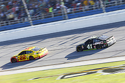April 29, 2018 - Talladega, Alabama, United States of America - Joey Logano (22) and Kurt Busch (41) race to the checkered flag to end the GEICO 500 at Talladega Superspeedway in Talladega, Alabama. (Credit Image: © Chris Owens Asp Inc/ASP via ZUMA Wire)