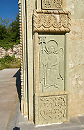 Pictures and images of bas relief sculpture of archangels on the chapel in the historic medieval Kintsvisi Monastery Georgian Orthodox Monastery complex, Shida Kartli Region, Georgia (country).<br /> <br /> Kintsvisi Monastery is the best preserved example of Georgian architecture of the 12th and 15th centuries, the so called Georgian Golden Age. .<br /> <br /> Visit our MEDIEVAL PHOTO COLLECTIONS for more   photos  to download or buy as prints https://funkystock.photoshelter.com/gallery-collection/Medieval-Middle-Ages-Historic-Places-Arcaeological-Sites-Pictures-Images-of/C0000B5ZA54_WD0s<br /> <br /> Visit our REPUBLIC of GEORGIA HISTORIC PLACES PHOTO COLLECTIONS for more photos to browse, download or buy as wall art prints https://funkystock.photoshelter.com/gallery-collection/Pictures-Images-of-Georgia-Country-Historic-Landmark-Places-Museum-Antiquities/C0000c1oD9eVkh9c