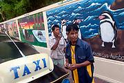 Tuc tuc drivers await customers, Dusit Zoo