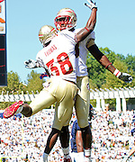 Oct 2, 2010; Charlottesville, VA, USA; Florida State Seminoles running back Chris Thompson (23) celebrates his touchdown with teammate Florida State Seminoles tight end Beau Reliford (88) during the game against the Virginia Cavaliers at Scott Stadium. Florida State won 34-14.  Mandatory Credit: Andrew Shurtleff