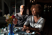 Ron and Serethea Reid at the dinner table in their Austin home on Chicago's Far West Side.