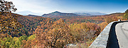 """View the Blue Ridge Mountains from Bear Den Overlook (elevation 3359 feet) at Milepost 323.0 of the Blue Ridge Parkway, in North Carolina, USA. Black bears no longer roam this area but once had dens here. The Blue Ridge Mountains are a physiographic province of the larger Appalachian division. The mountains are known for their bluish color when seen from a distance. Trees put the """"blue"""" in Blue Ridge, from the hydrocarbons released into the atmosphere, thereby contributing to the characteristic haze on the mountains and their distinctive color. The Blue Ridge Parkway is a 469-mile (755 km) long scenic highway that connects Shenandoah National Park, Virginia, with the Great Smoky Mountains National Park in North Carolina and Tennessee, and is located along the ridge crestlines along the Appalachian Trail. Panorama stitched from 3 overlapping photos."""