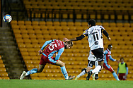John McAtee (45) of Scunthorpe United Cristian Montaño (11) of Port Vale battles for possession during the EFL Sky Bet League 2 match between Port Vale and Scunthorpe United at Vale Park, Burslem, England on 17 November 2020.