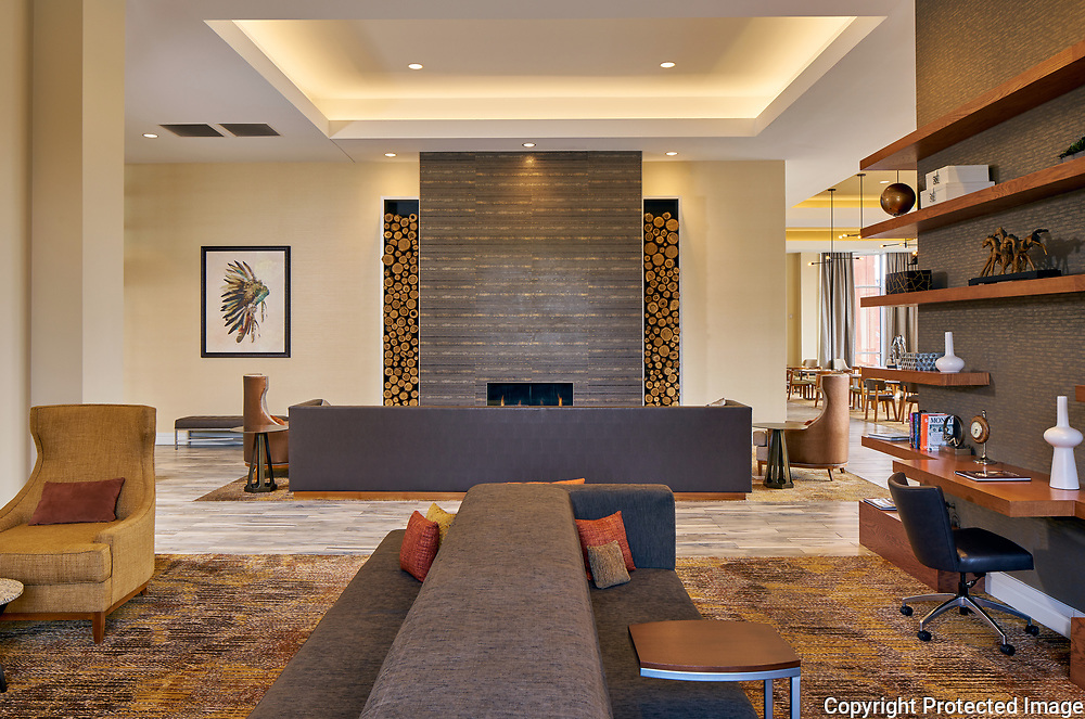 Residence Inn by Marriott Kansas City seating area with fireplace. Designed by Collaborative Studios in Nashville, TN. Photographed by Nashville architectural and interior photographer Sanford Myers.