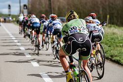 Alison Tertrick reaches for a bottle - Women's Gent Wevelgem 2016, a 115km UCI Women's WorldTour road race from Ieper to Wevelgem, on March 27th, 2016 in Flanders, Belgium.
