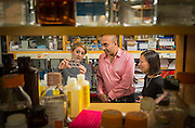 A professor in neuroscience talks with his graduate students. (Photo @ Andy Manis)