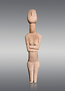 Cycladic Canonical type, Spedos variety female figurine statuette. Early Cycladic Period II from Syros phase , (2800-2300 BC). Attributed to the 'Copenhagen Master' Museum of Cycladic Art Athens,  Against Grey Background. <br /> <br /> The short legs have no knees and end in rudimentary feet. The legs probably broke at the knees and an artists remodelled  the truncated legs with toes. It is a rare example of remodelling in Cycladic art