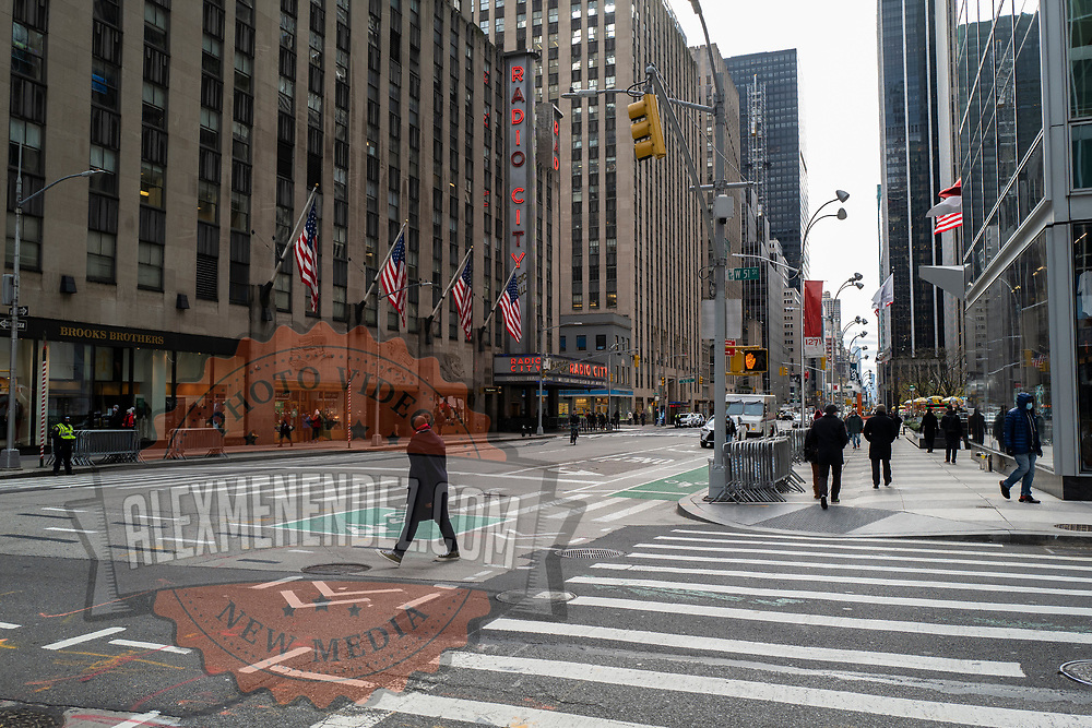 Radio City Music Hall stands alone and the streets remain empty during the holiday season with the Coronavirus (Covid-19) outbreak in Manhattan, New York on Tuesday, December 8, 2020. (Alex Menendez via AP)