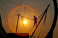 A child bounces on the Vertical Reality ride at the Sheakleyville Fair as the sun sets Friday, August 3, 2012.