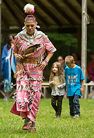 Kristy Montry of Minnesota dances in a Ojibwe jingle dress on Saturday afternoon at the LIHA Labor Day Pow Wow in Sanbornton.  (Karen Bobotas/for the Laconia Daily Sun)