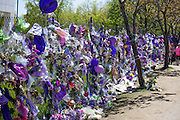 Fence around Paisley Park filled to the top with Prince memorials honoring his life and music. Chanhassen Minnesota MN USA