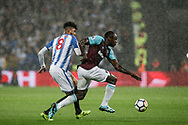 Philip Billing of Huddersfield Town closes down Michail Antonio of West Ham united ®.  Premier league match, West Ham Utd v Huddersfield Town at the London Stadium, Queen Elizabeth Olympic Park in London on Monday 11th September 2017.<br /> pic by Kieran Clarke, Andrew Orchard sports photography.