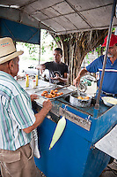 A bustling local market in a small town on the journey from Santa Clara to Trinidad, Cuba.