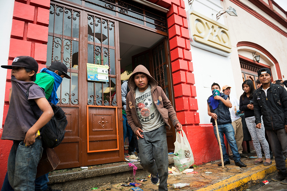 A boy is among the looters cleaning out an OXXO convenience store in San Cristobal de las Casas, Mexico. This day demonstrations where held across Mexico to protest the government's handling of and involvement in the disappearance of 43 students on September 26, 2014 in Iguala.