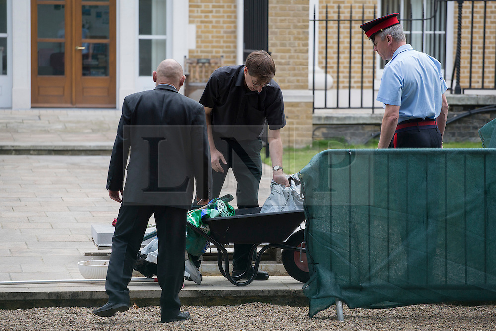 © licensed to London News Pictures. London, UK 28/09/2013. Staff of the Royal Hospital placing of the headstone of Margaret Thatcher within the grounds of the Royal Hospital after a short church service with members of the Thatcher family and Chelsea Pensioners followed by the internment of Margaret Thatcher's ashes. Photo credit: Tolga Akmen/LNP