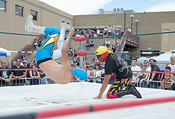 July 23, 2017 - Denver, Colorado, U.S - Denver County Fair goers watch Lucha Libre during the 7th. Annual Denver County Fair at the National Western Complex Sunday afternoon. (Credit Image: © Hector Acevedo via ZUMA Wire)